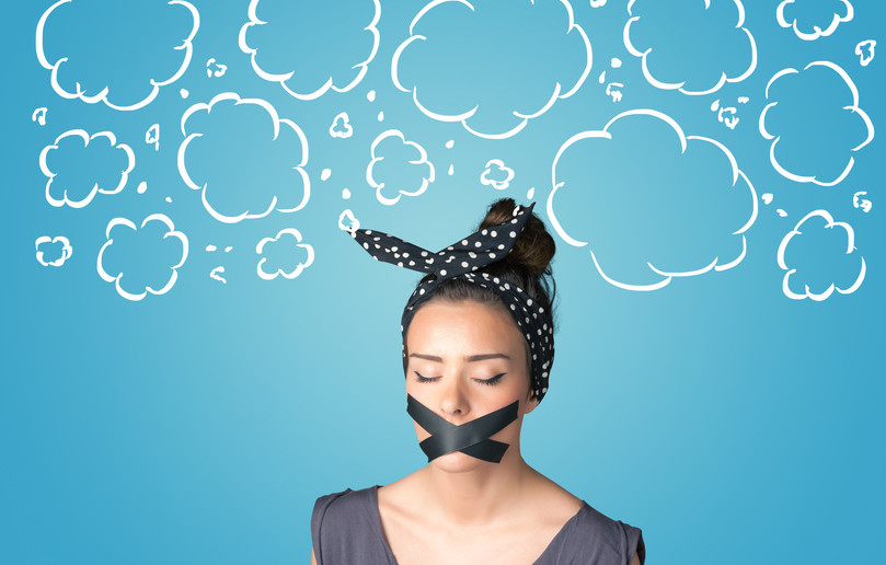 thinking woman with tape over mouth