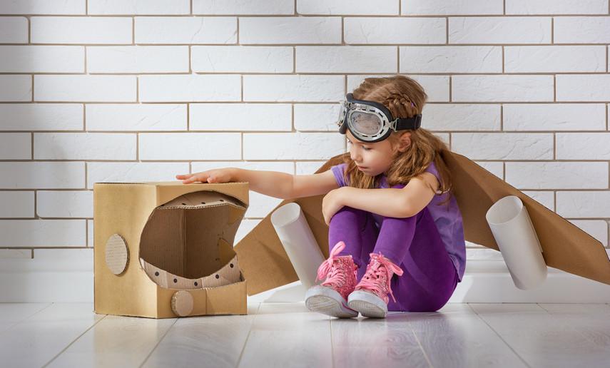 girl playing as astronaut