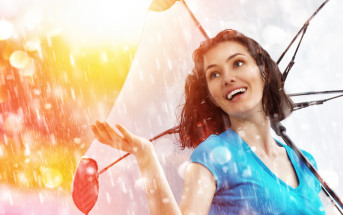 smiling woman with umbrella