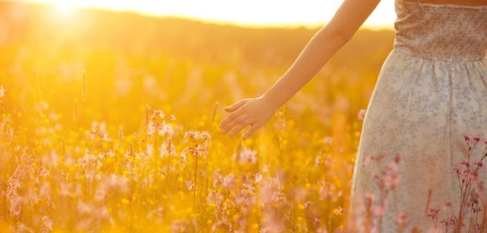 woman walking through corn field