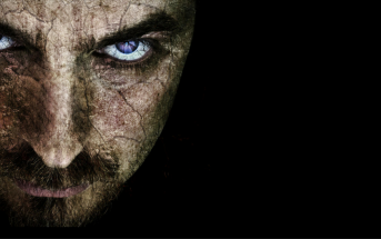 man with evil face on dark background