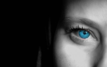 closeup of woman's face blue eye