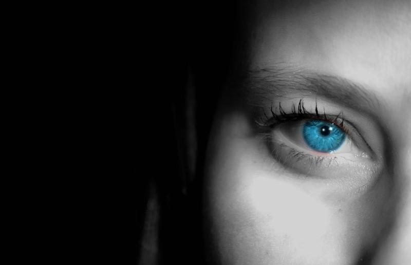 closeup of woman's face blue eye