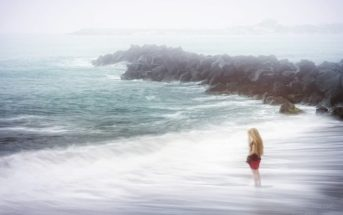 woman on stormy beach