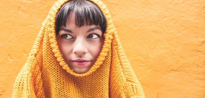woman with jumper around head - concept of uncomfortable feelings