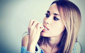 woman biting nails
