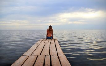 woman alone on jetty