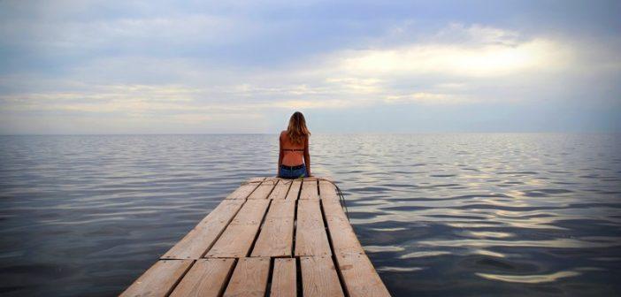 woman alone on jetty