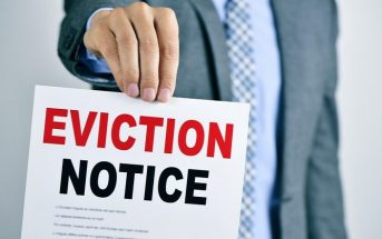 man holding eviction notice