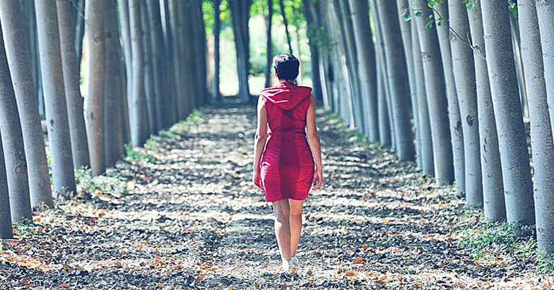 woman walking wooded path
