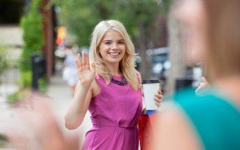 woman waving goodbye to a friend