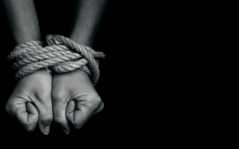 hands bound with rope - slave