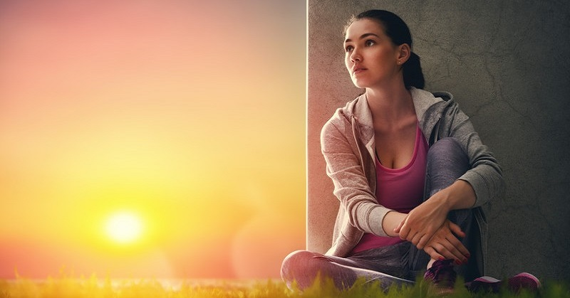 woman sitting down after exercise