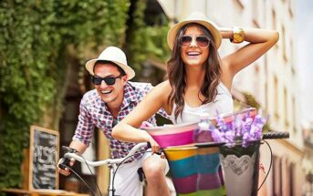 happy looking couple on bikes