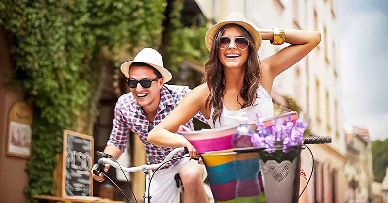 happy looking couple on bikes