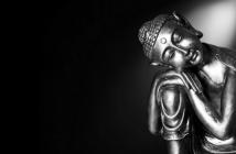 statue of Buddha against dark background