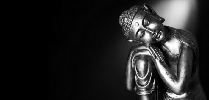 statue of Buddha against dark background