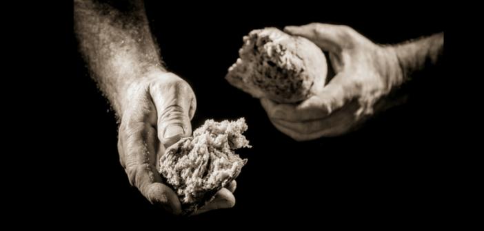 hands breaking bread