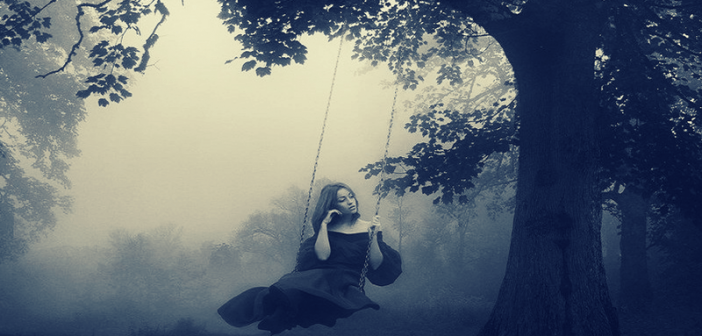 woman sitting on swing in fog