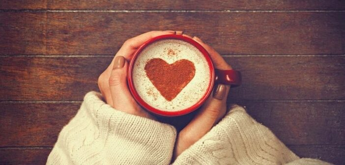 woman with coffee heart shape