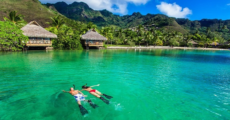 successful couple snorkelling