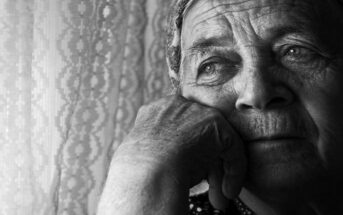 old woman thinking about the past and her regrets