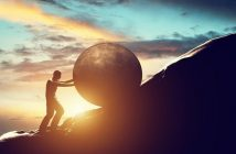 Sisyphus rolling rock illustrating personal struggle