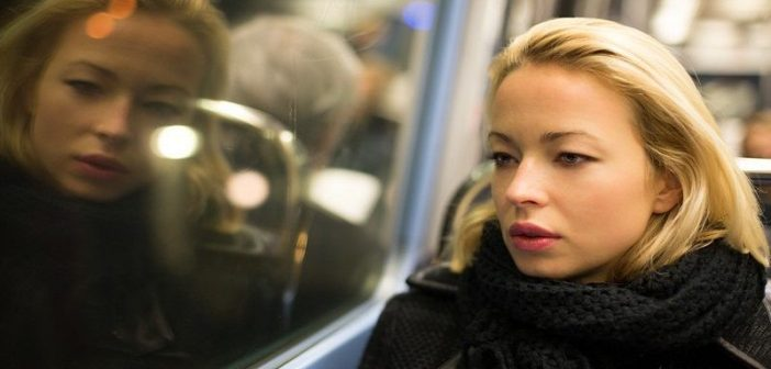 thoughtful looking woman on train