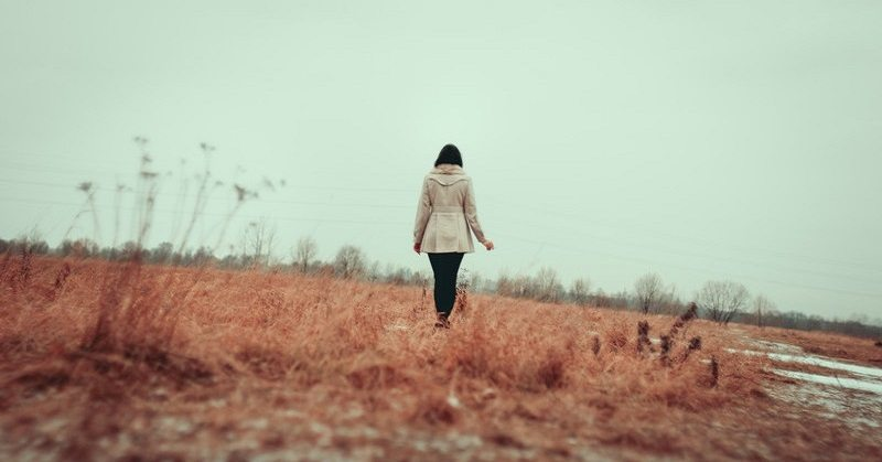 woman walking away - reinventing yourself concept