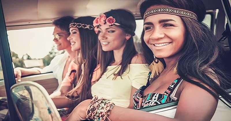 happy looking friends in car