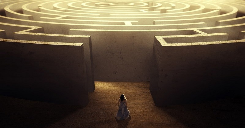 woman entering maze - concept of self-improvement