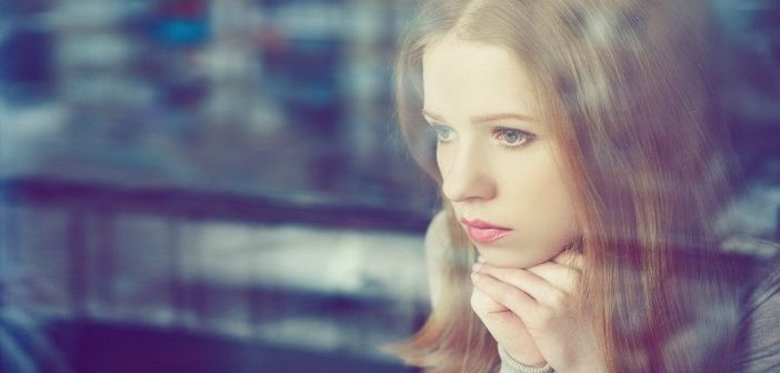 thought woman at window - concept of self-limiting beliefs