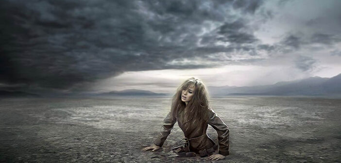 woman stuck in ground - concept of emotionally drained