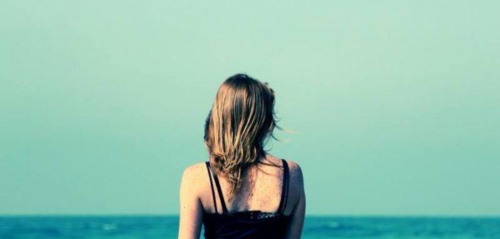 woman looking out across ocean
