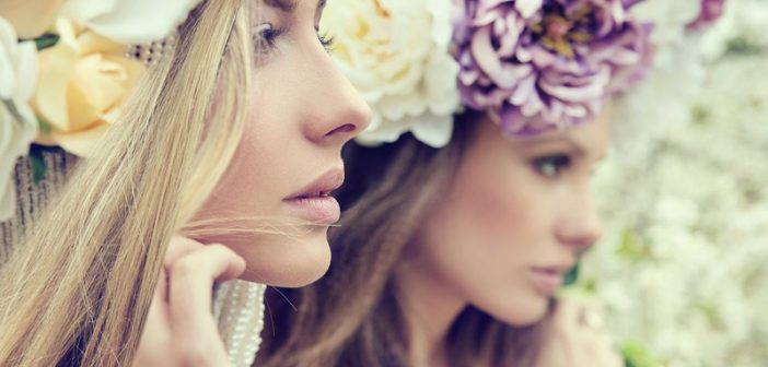 2 young women with flowers in hair - concept of highly sensitive people