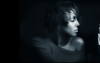 portrait of woman on dark background - concept of finding strength