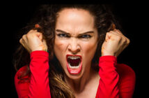 angry woman with clenched fists