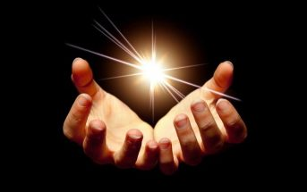 hands holding light - concept of lightworker