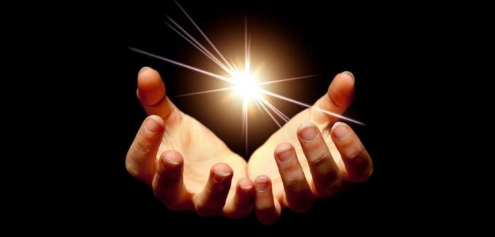 hands holding light - concept of lightworker