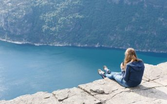 woman sitting on cliff edge - concept inner monologue