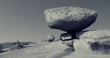 picture of a gray rock balancing in landscape