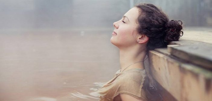 woman relaxing in natural spring - concept of highly sensitive person
