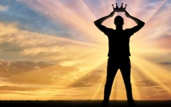 man holding crown above his head - concept of narcissist
