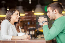 man and woman talking in coffee shop