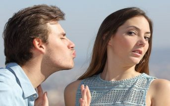 woman avoiding kiss from man - concept of unrequited love