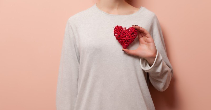 woman holding heart - concept of self-love