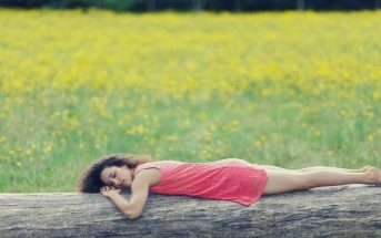 woman lying on log - running on empty