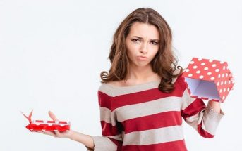 woman looking sad at empty gift box