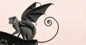 statue of monkey with wings signifying a Flying Monkey
