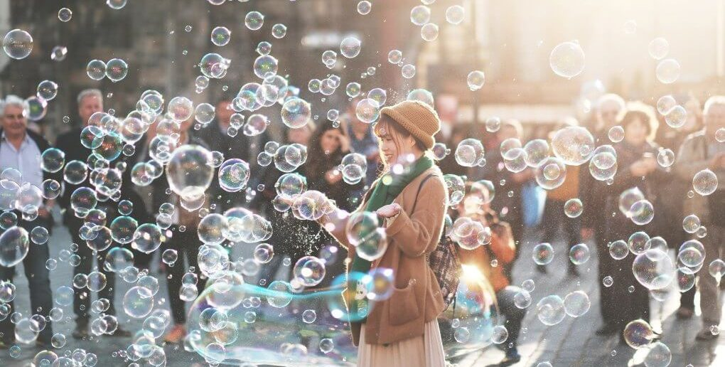 woman surrounded by bubbles not taking life seriously